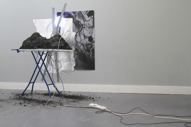 JESSICA_RAMM_coal_ash_power_station_waste,_ironing_board,_iron,_aluminium_foil,_iron_filings_print,_electrical_components_2017.jpg